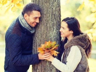 man gives flowers to woman signs he likes you more than a friend